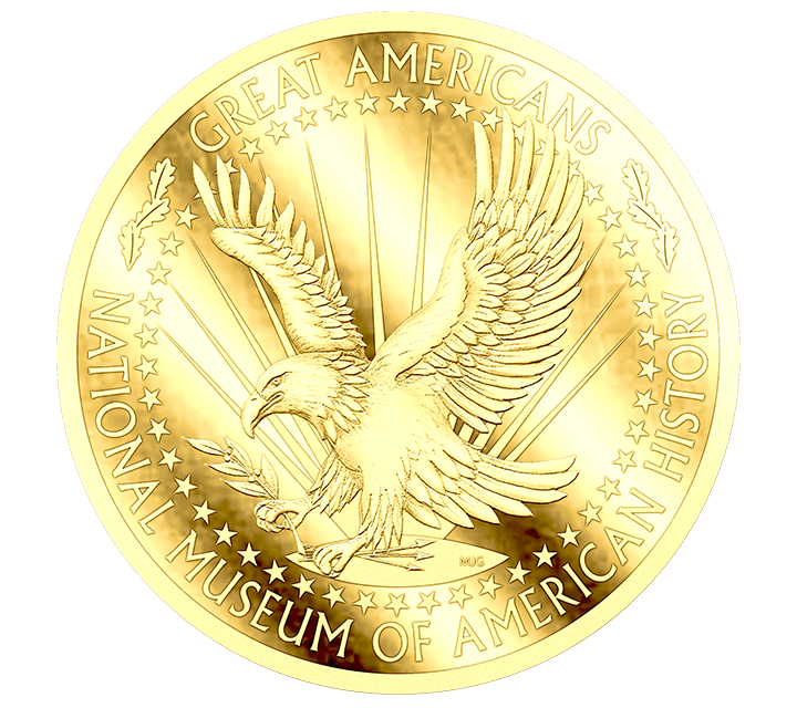 A gold coin with an eagle swooping in the middle