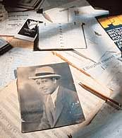Assorted papers and photos on a table