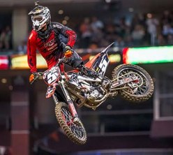 Adaptive motocross racer Mike Schultz rides during an event