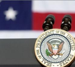 Close photograph of podium with presidential seal