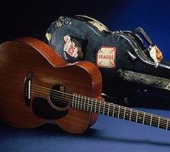 Guitar and case belonging to Elizabeth Cotten