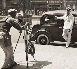 Photographer Zack Brown shooting dapper men in Harlem, c. 1937 by Eliot Elisofon, Collection of the Smithsonian National Museum of African American History and Culture, © Harry Ransom Center, The University of Texas at Austin