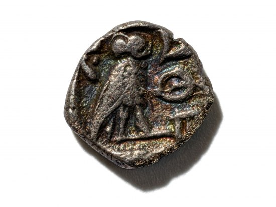 Chunky metal coin with image of owl in it. Image is a little rough and not perfectly clear.