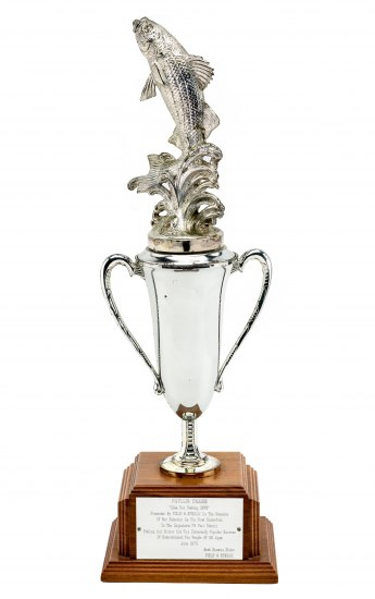 A standard trophy with a golden fish leaping out of the top, creating splashes of water after it. Diller's name is inscribed on the front.