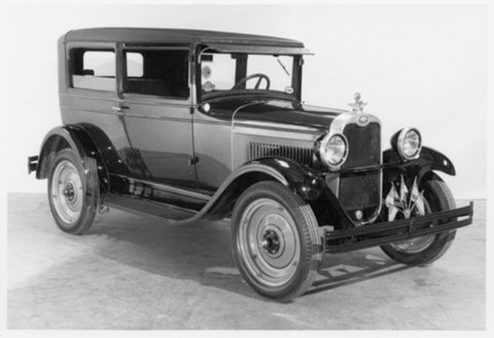 Black and white photograph of a 1928 Chevrolet Sedan in the museum's collections.
