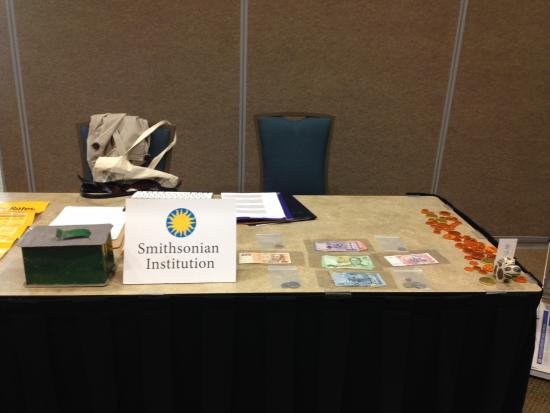 Table with Smithsonian sign, examples of money