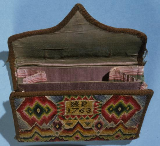 Pocketbook, open, with intricate design in variety of colors