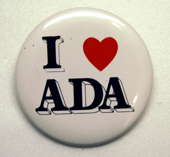 "Circular white button with bold, capitalized text saying ""I [heart symbol] ADA"""