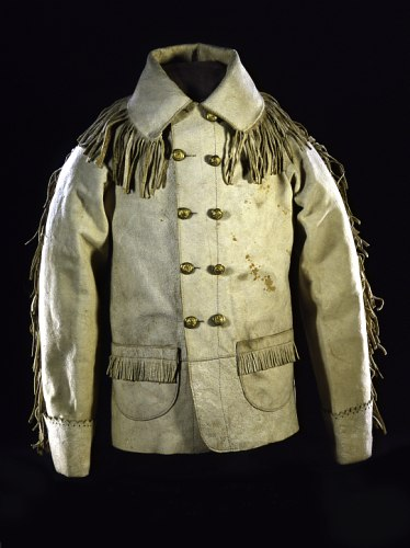 A white leather coat with brass buttons and fringe on the shoulders and sleeves