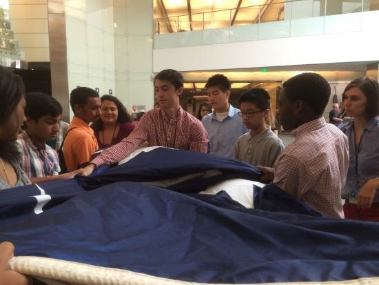 Teens fold a flag