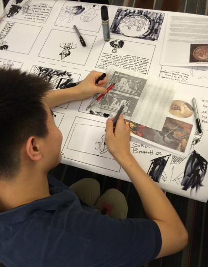 Young man working on a black-and-white comic book
