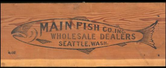 Label for shipping crate with large fish and text inside