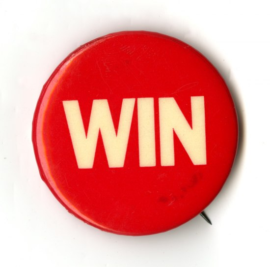 A red button with the word Win in all caps in white on it.