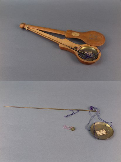 Two images juxtaposed. On the top is a wooden case with the cover pushed to the side. Inside there is a metal dish with purple strings. On the bottom there is a rod with a dish connected by metal strong and a small circular metal object with pink string.