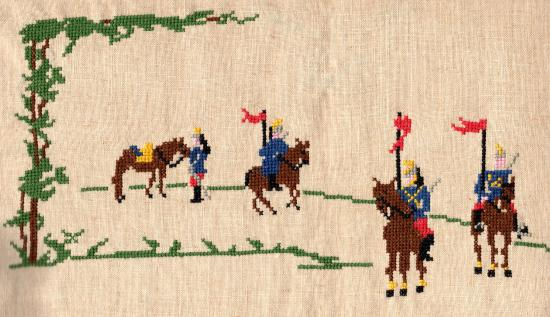 An embroidered scene of soldiers on horses and in a line with flags