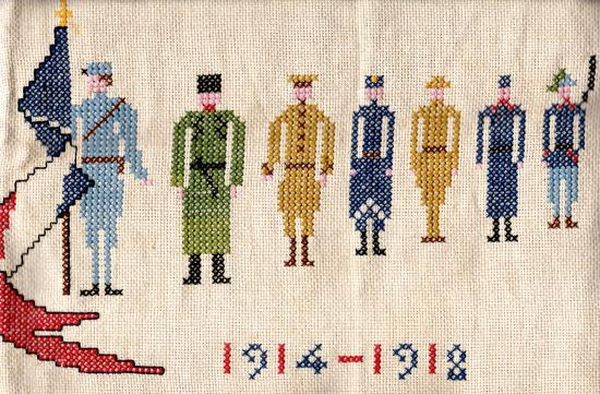 An embroidered scene of soldiers in a line with flags