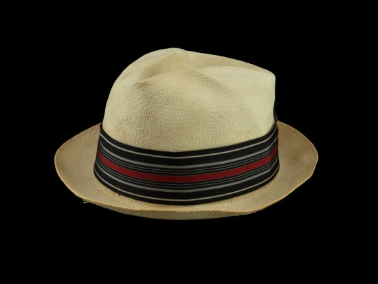 Photograph of off-white, straw fedora worn in the summer months by Harold Cotton.