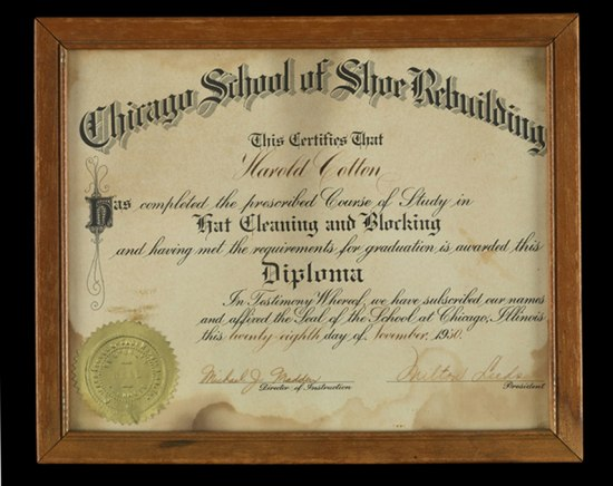 Photograph of Cotton's framed diploma from the  Chicago School of Shoe Rebuilding, 1950.