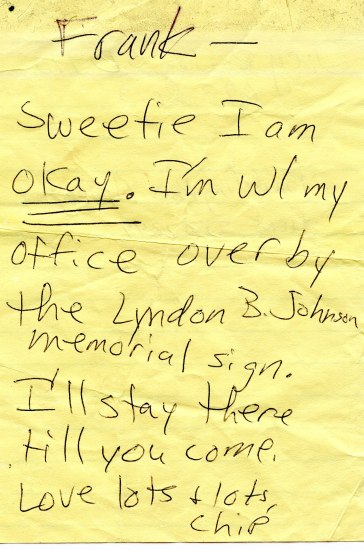 A handwritten note hastily scrawled on a large rectangular yellow Post-it