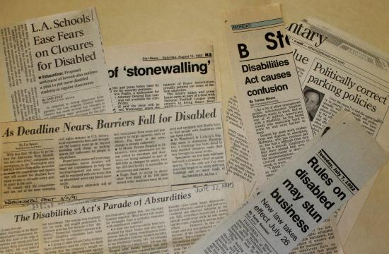 "Pile of articles clipped from newspapers. Headlines are somewhat visible: ""L.A. Schools Ease Fears on Closure for Disabled."" ""As Dealine Nears, Barries Fall for Disabled."" ""The Disabilities Act's Parade of Absurdities."" ""Rules on disabled may stun business."" ""Politically correct parking policies."" ""Disabilities Act causes confusion."""