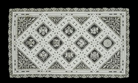 Table cloth with diamond-shaped designs inside larger diamonds