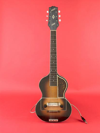 Guitar on red background