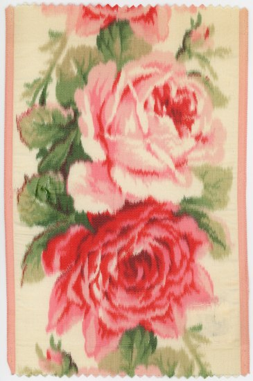 Piece or ribbons showing two pink flowers that may be roses or peonies, with abundant petals. Green leaves surround them. One is lighter pink, the other darker. Both are hazy in appearance.