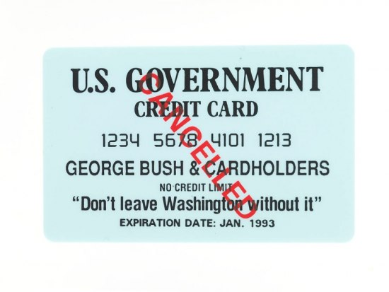 """A light blue credit card. At the top it says """"U.S. Government Credit Card"""" with """"George Bush & Cardholders"""" on it. In red, the word """"Cancelled"""" is written diagonally."""