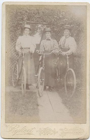 Three women with bicycles