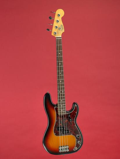 Electric bass guitar on red background