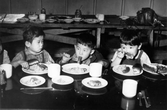 Three children eating