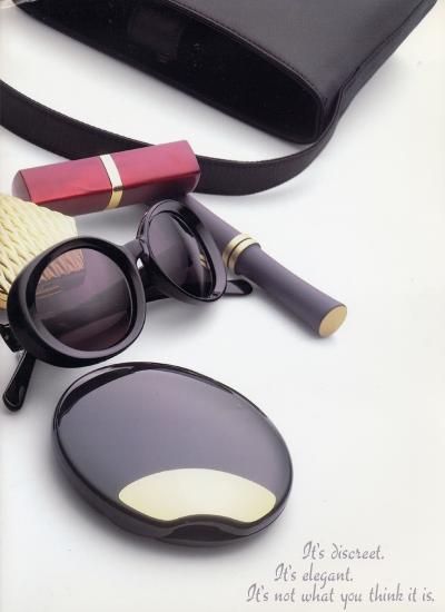 Ad featuring lipstick, sunglasses, pill pack