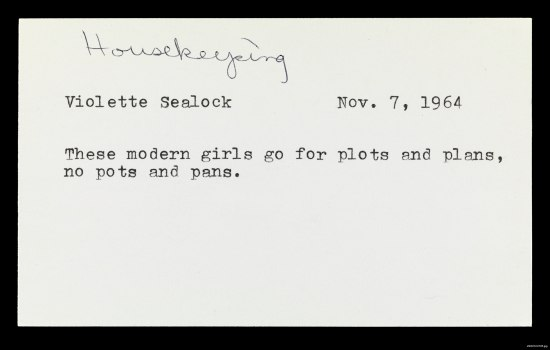 A small, index-sized card with typewritten text and a handwritten note at the top