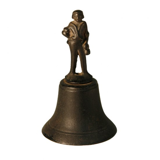 Bell topped with a human figure