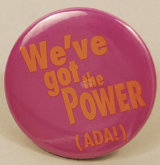 "Pin pin. In yellow bold text: ""We've got the power! (ADA)!"""