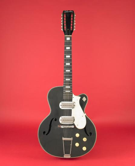 Black and white guitar on red background