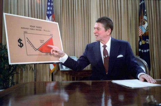 """President Ronald Regan sits in the Oval Office behind a desk. He is pointing to a graph behind him titled """"Your Taxes."""""""