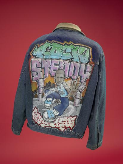 Denim jacket, back shown, with graffiti-style imagery