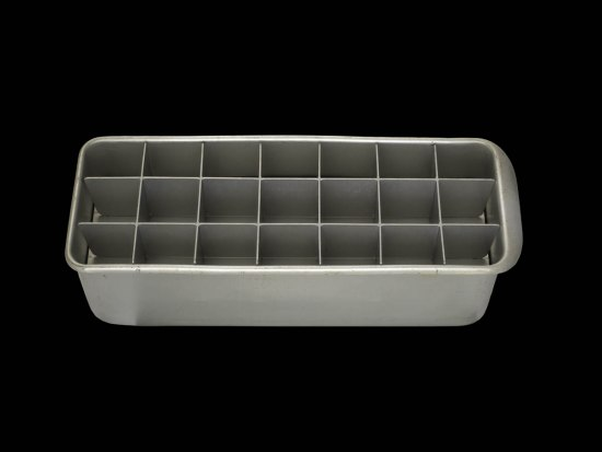 An old, gray metal ice cube tray with room for 21 cubes