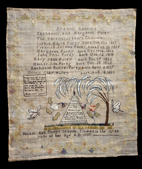An embroidery shows a pyramidal monument flanked by rosebushes and butterflies, under a weeping willow tree
