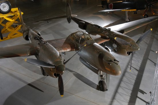 Photograph of a Lockheed P-38J-10-LO Lightning in a hangar.