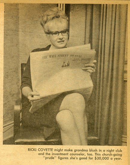 Yellowed clipping from a magazine of a woman in a chair, her legs crossed, reading the Wall Street Journal