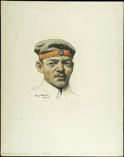 A portrait of a head of a man who is wearing a floppy olive-colored cap with an orange ribbon going around the brim.