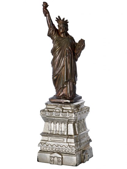 Six-inch tall statue of liberty souvenir featuring iconic statue on top of base