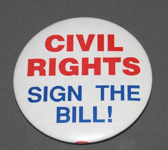 "White pin. Red text in bold typeface: ""CIVIL RIGHTS."" Blue text in bold typeface: ""SIGN THE BILL!"""