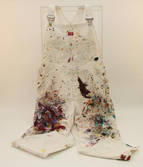 Photograph of white overalls splattered with paint