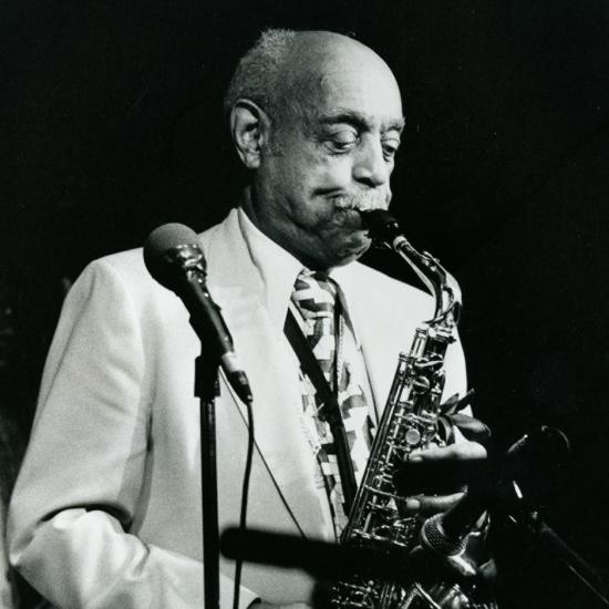 Benny Carter playing saxophone