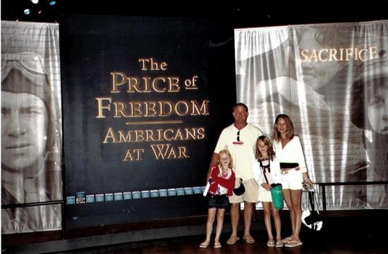 "Susan and Craig with their daughters at ""Price of Freedom: Americans at War"" exhibition"