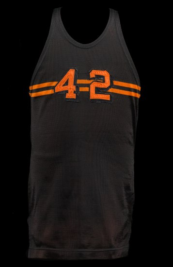 Photo of black jersey (sleeveless) with two orange bars and the number