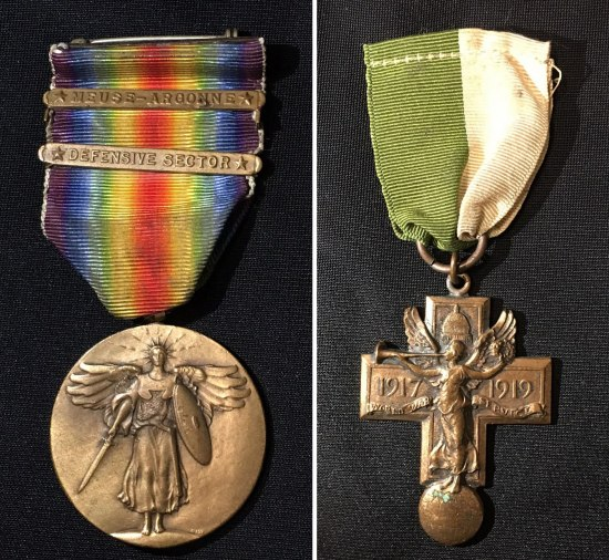 Two photos of medals. On righta cross-shaped medal with a figure of a winged woman. It has a green and white ribbon. On left, a circular medal with a winged woman holding a sword. It has a rainbow colored ribbon.
